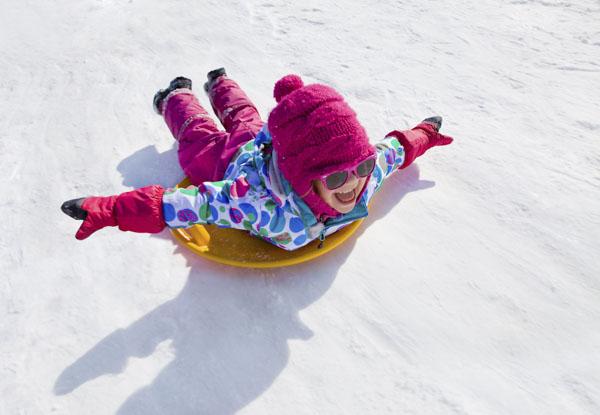 Girl flying on snow