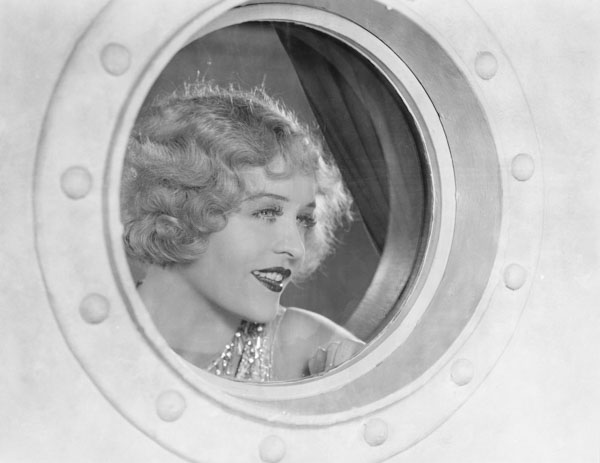 woman looking out of porthole