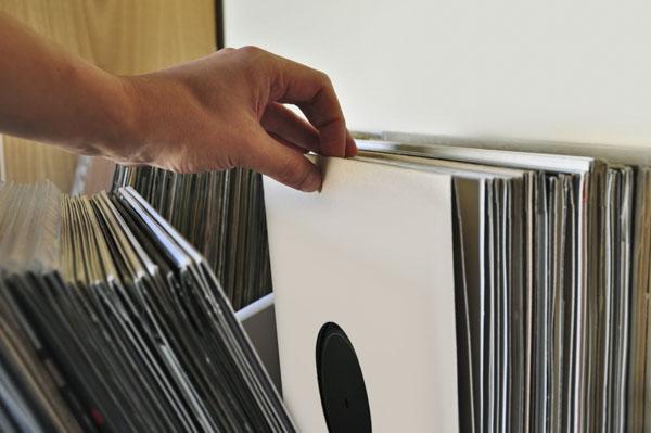 Browsing through vinyl records collection
