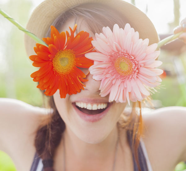 girl with flowers on eyes