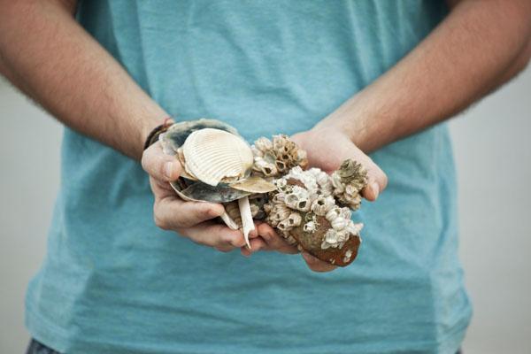man holding shells