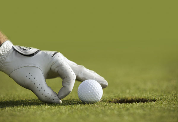 Golfer nudging ball