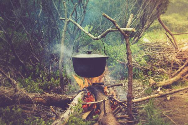 cast iron pot over campfire