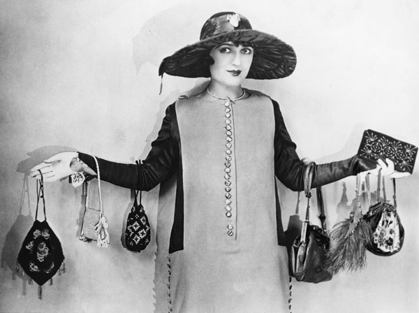 Woman with vintage purses