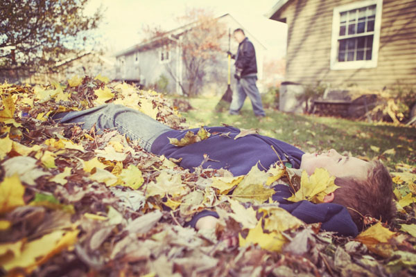 Boy in fall leaves