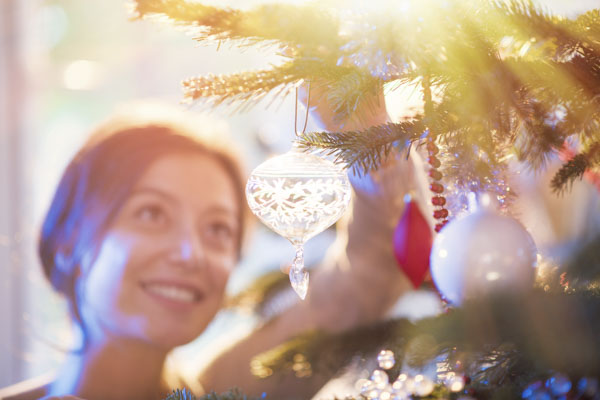 Woman hanging ornament