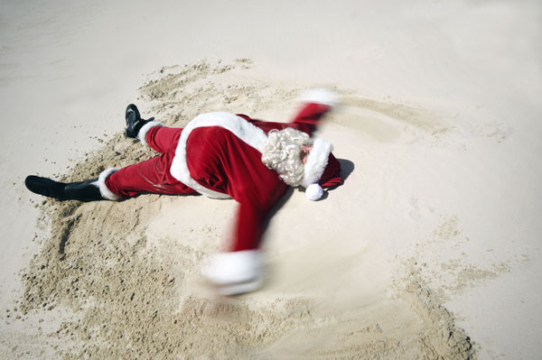 Santa making sand angels