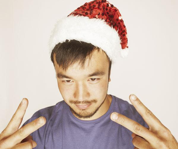Man in Santa hat smiling