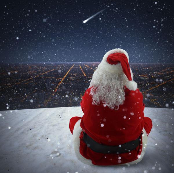 Santa Claus watches a sparkling falling star