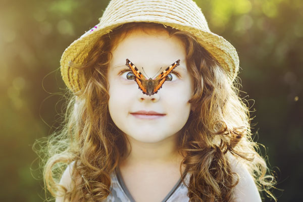 Girl with a butterfly on her nose