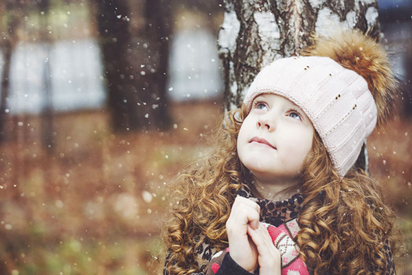 Praying little girl looking up