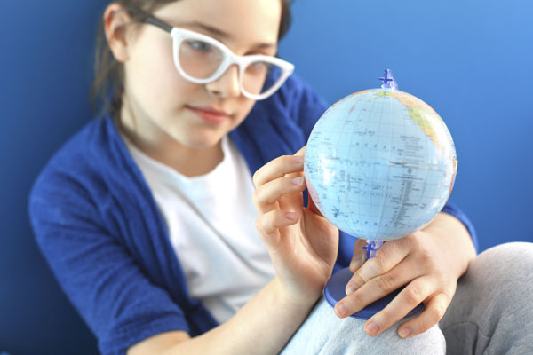 Girl pointing to dream destination