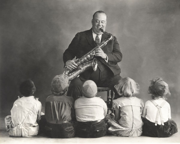 Musician playing for children
