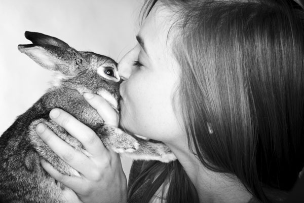 Woman kissing rabbit