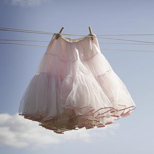 Pink slip on clothesline