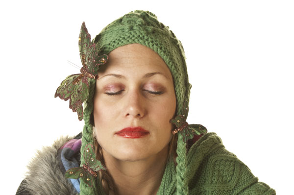 Woman wearing knitted hat with butterfly