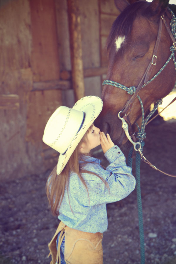 Little cowgirl and her horse
