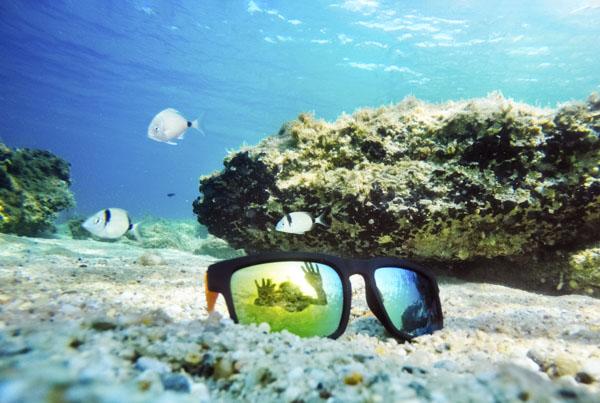 Mirror sunglasses on ocean floor