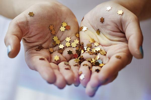 Hand holding star confetti