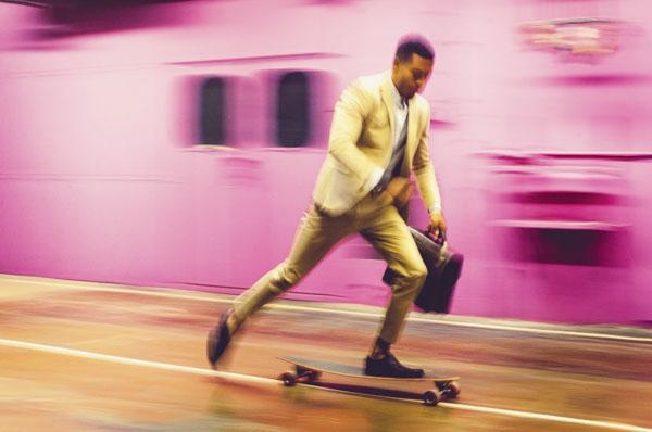 Man riding to work on skateboard