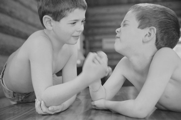 Two brothers arm wrestling