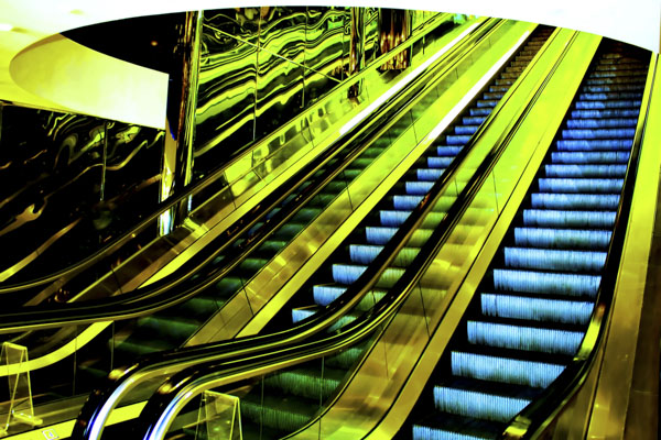 Blue and green escalator