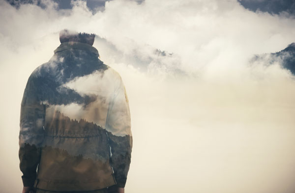 man walking into the clouds