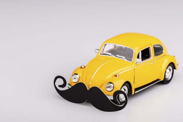 Yellow beetle car with mustache