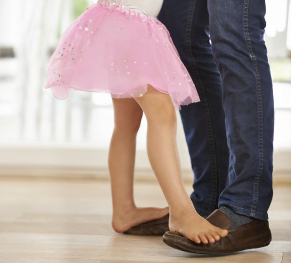 Daughter dancing with her father