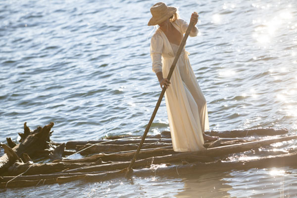 Woman on a wooden raft
