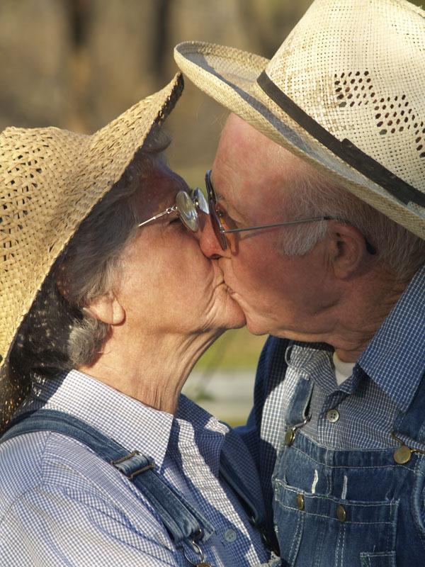 Kissing elderly couple