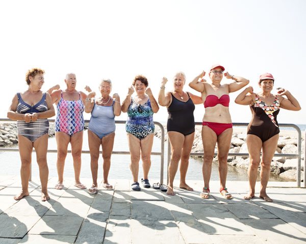 Group of senior women flexing their muscles