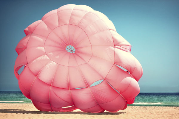 Pink parachute on beach