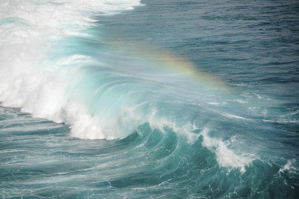 Ocean wave with rainbow