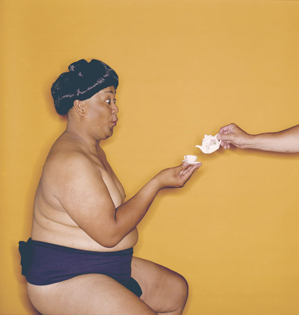 Sumo wrestler drinking tea