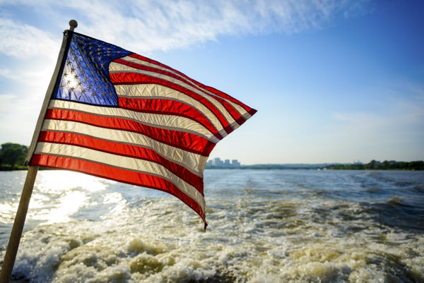 American flag waving from boat