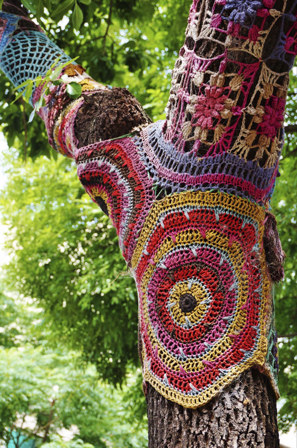Yarn bombed tree in park
