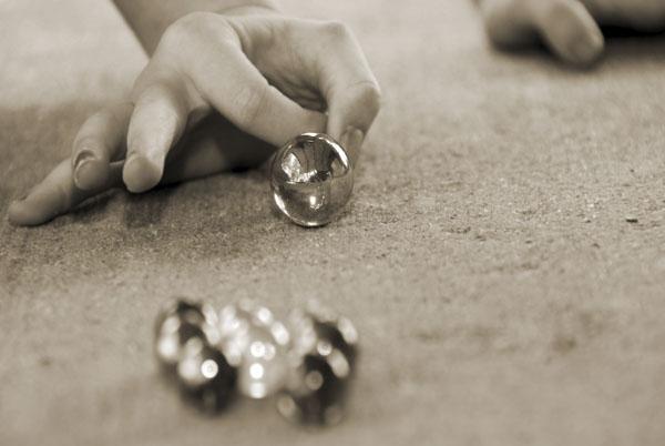 Kid shooting marbles
