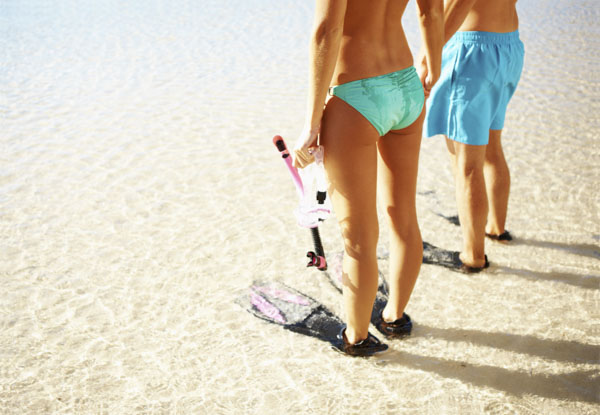 Couple getting ready to snorkel