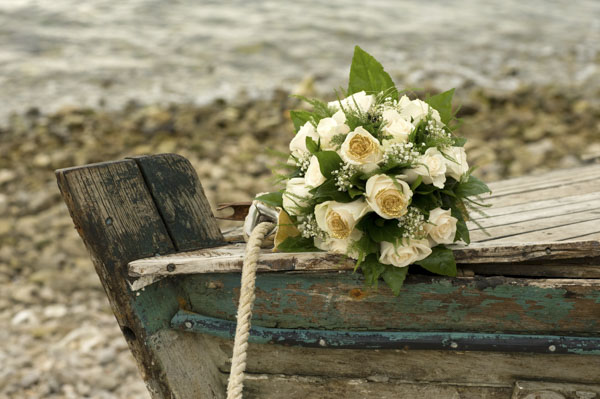 Wedding bouquet on old wooden boat
