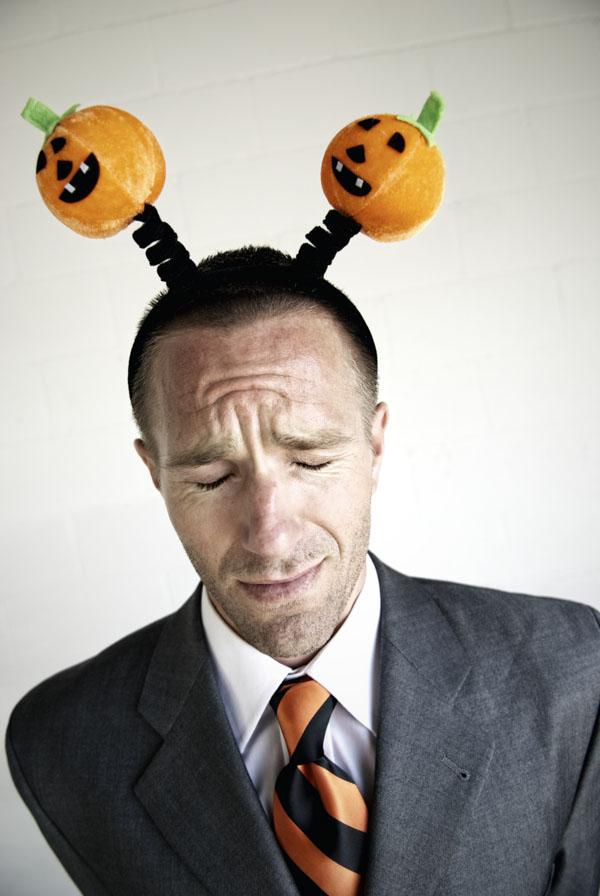 Halloween businessman wearing Jack-o-Lantern headband
