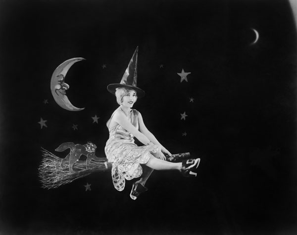 Vintage witch on broom