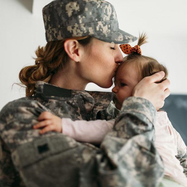 Soldier hugging her child