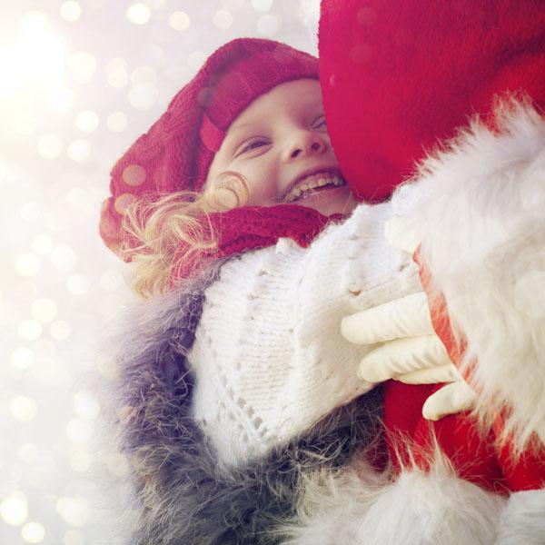 Little girl hugging Santa