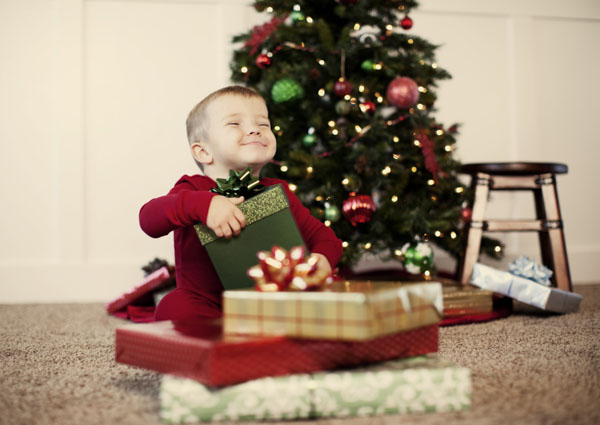 Little boy opening present on Christmas