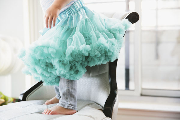 Girl on chair in ballet tutu