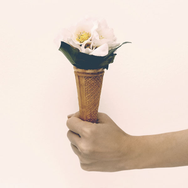Giving gift of flowers in waffle cone