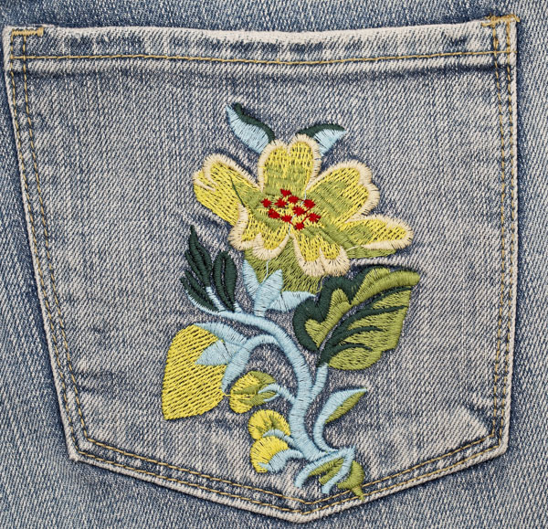 Flower embroidery stitched on jean pocket