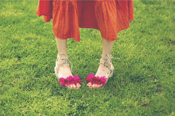 Woman with cute flower sandals