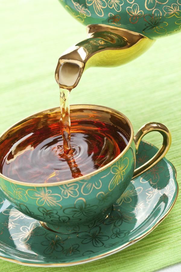 Tea in a green and gold shamrock antique porcelain mug